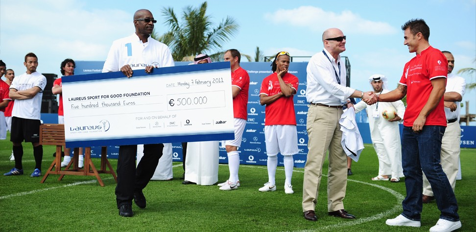Laureus Football Game Georges Presents Cheque